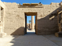 Ruins of an ancient temple of Egypt with statues and columns Stock Images