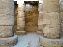 Ruins of an ancient temple of Egypt with statues and columns Royalty Free Stock Images