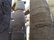 Ruins of an ancient temple of Egypt with statues and columns Stock Photos