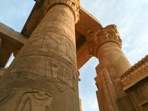 Ruins of an ancient temple of Egypt with statues and columns Stock Photography