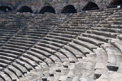 Ruins of ancient theater. Seats and arches Royalty Free Stock Images