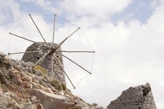 Ruins of ancient Venetian windmills built in 15th century, Lassithi Plateau, Crete, Greece. Most typical characteristic of the Plateau. In the past, they Stock Images