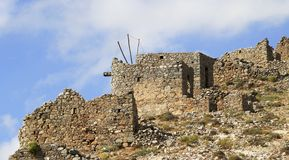 Ruins of ancient Venetian windmills built in 15th century, Lassithi Plateau, Crete, Greece. Most typical characteristic of the Plateau. In the past, they Stock Photography
