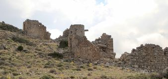 Ruins of ancient Venetian windmills built in 15th century, Lassithi Plateau, Crete, Greece. Most typical characteristic of the Plateau. In the past, they Royalty Free Stock Images