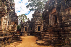 Ruins of Angkor Wat, part of Khmer temple complex, Asia. Siem R. Eap, Cambodia. Ancient Khmer architecture in jungle Stock Image