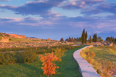 Ruins of antique city path park sunset Pamukkale Stock Photography