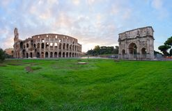 Colosseum at sunset in Rome, Italy. Ruins of antique Colosseum and Arch of Constantine in sunise lights, Rome Italy Royalty Free Stock Photography