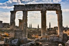 Ruins of Appollo temple with fortress at back in ancient Corinth, Peloponnese, Greece.  stock images