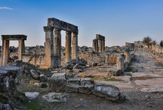 Ruins of Appollo temple with fortress at back in ancient Corinth, Peloponnese, Greece.  royalty free stock photos