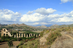 Ruins of aqueduct in Aspendos Stock Photography