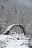 Arch bridge in mountains during winter, South Alps, Italy. Ruins of arch bridge in mountains during winter, Rezzo municipality, Province of Imperia, Italy Stock Photography
