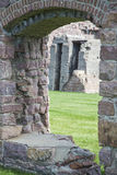 Ruins arch window doorway stone lawn Stock Photography