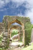 Ruins of Archway in Madan Mahal fort. Madan Mahal Fort situated on a top of a hill dates back to 11th century AD Royalty Free Stock Photo