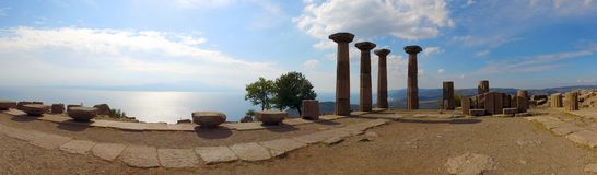 Ruins of Assos, Canakkale, Turkey. Pillars in ruins of ancient city of Assos in Canakkale, Turkey in panorama against blue skies Stock Image