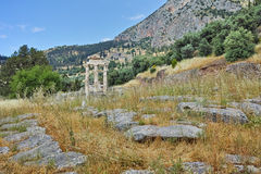 Ruins of Athena Pronaia Sanctuary in Ancient Greek archaeological site of Delphi, Greece Stock Photos