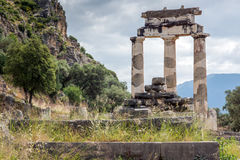 Ruins of Athena Pronaia Sanctuary at Ancient Greek archaeological site of Delphi, Greece Royalty Free Stock Image