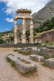 Ruins and Athena Pronaia Sanctuary at Ancient Greek archaeological site of Delphi, Greece Royalty Free Stock Photo
