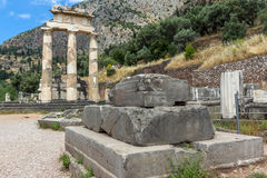 Ruins of Athena Pronaia Sanctuary at Ancient Greek archaeological site of Delphi, Greece Stock Images