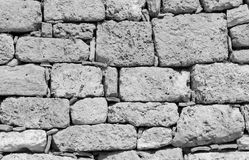 Ruins of atique stone wall background black and white. Ruins of atique stone wall background Stock Image