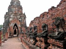 Ruins at Ayuttaya, Thailand. Headless statues of the Buddha line a wall at Ayuttaya, which was sacked by the Burmese  in 1767 Stock Images