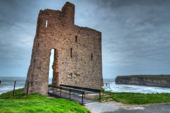 Ruins of Ballybunion castle. On the coast of Atlantic ocean, Ireland Stock Photography