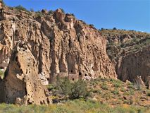 Ruins in Bandelier National Monument. A trail winds through Frijoles Canyon to Native American ruins in Bandelier National Monument Stock Image