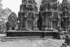 Ruins of Banteay Srei at the Angkor Wat complex. Black and white image of the Banteay Srei ruins in the historic Angkor Wat religious temple complex. This stock photo