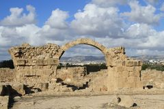 The ruins of the Basilica of archaeology arch masonry the antiquity of the city. Ancient landmark, the ruins of a Basilica with well-preserved arch of entrance Royalty Free Stock Image