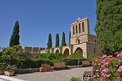 Ruins of beautiful Bellapais monastery, Northern Cyprus. In Kyrenia province, near the town of Kyrenia (Girne) lies a small village of Bellapais. In the times of stock photos
