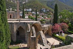 Ruins of beautiful Bellapais monastery, Northern Cyprus. In Kyrenia province, near the town of Kyrenia (Girne) lies a small village of Bellapais. In the times of royalty free stock photography