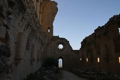 Ruins of beautiful Bellapais monastery, Northern Cyprus. In Kyrenia province, near the town of Kyrenia (Girne) lies a small village of Bellapais. In the times of stock photo