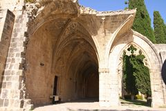 Ruins of beautiful Bellapais monastery, Northern Cyprus. In Kyrenia province, near the town of Kyrenia (Girne) lies a small village of Bellapais. In the times of royalty free stock images