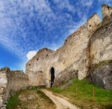 Ruins of Beckov castle. With blue sky and cloudscape background, Trencin, Slovakia royalty free stock photography