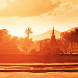 Ruins of big Buddhist temples in tropical forest on sunset. Royalty Free Stock Images