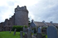 Ruins of the Bishop`s Palace and cemetery at Saint Magnus cathedral, Kirkwall, Orkney Islands. Saint Magnus Cathedral dominates the skyline of Kirkwall, the main Royalty Free Stock Photo