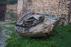 Ruins of a boat in Oia town, Santorini island, Greece. Cityscape of Oia town with ruins of a boat, Santorini island, Greece Royalty Free Stock Images