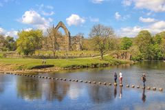 Bolton Abbey, Yorkshire, England. The ruins of Bolton Abbey in the Yorkshire Dales National Park, England. Situated on the banks of the river Wharfe - the iconic Stock Images