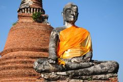Ruins buddha statue  with pagoda Royalty Free Stock Images