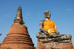 Ruins buddha statue  with pagoda Stock Photo