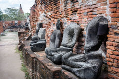 Ruins of Buddha statues in ancient temple. In Ayutthaya, Thailand Royalty Free Stock Photo