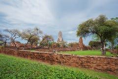 Ruins of buddha statues and pagoda of Wat Ratcha Burana in Ayutt. Ruins of buddha statues and pagoda of Wat Ratcha Burana temple in Ayutthaya historical park Royalty Free Stock Photo