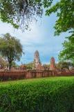 Ruins of buddha statues and pagoda of Wat Ratcha Burana in Ayutt. Ruins of buddha statues and pagoda of Wat Ratcha Burana temple in Ayutthaya historical park Royalty Free Stock Image