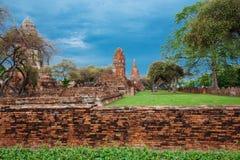 Ruins of buddha statues and pagoda of Wat Ratcha Burana in Ayutt. Ruins of buddha statues and pagoda of Wat Ratcha Burana temple in Ayutthaya historical park Stock Photo
