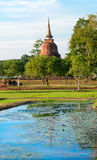 Ruins of Buddhist stupa or chedi in Sukhothai historical park in Stock Photography