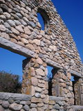 Ruins of old stone building. Bright blue sky shows through stone ruins in Rhode Island by the beach Royalty Free Stock Photo