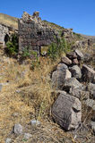 Ruins of buildings and khachkars 5-7 centuries in an ancient monastery Tsahats-kar in Armenia Stock Photography