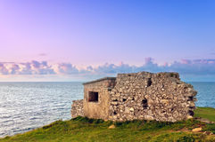 Ruins of bunker near sea Royalty Free Stock Photo