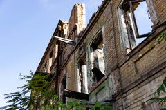 The ruins of a burnt down ancient house. Dnipro, Ukraine, November 2018. The ruins of a burnt down ancient house in the city center on Troitska street. Dnipro royalty free stock photography