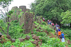 Ruins of Cabo de Rama Fort. Goa, India – July 10, 2016: Tourists at the ruins of Cabo de Rama Fort in Goa, a centuries old fort, last owned by the stock photography