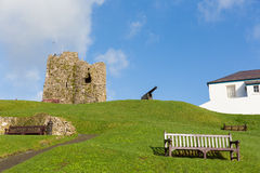 Ruins and cannon Tenby hill Pembrokeshire Wales UK Stock Image